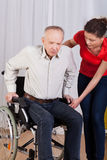 Nurse helps to get up disabled Royalty Free Stock Photography
