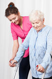 Nurse helps to walk the old woman Stock Photos