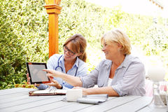 Nurse and her patient at home Stock Photography