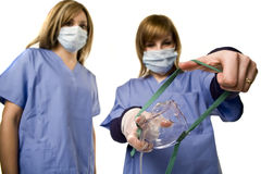 Nurse holding anesthesia mask Royalty Free Stock Photos