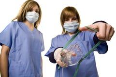 Nurse holding anesthesia mask royalty free stock photos