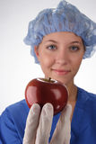 Nurse Holding Apple Royalty Free Stock Photography