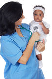 Nurse holding baby Royalty Free Stock Image