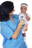 Nurse holding baby royalty free stock image