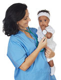Nurse holding baby Stock Photography