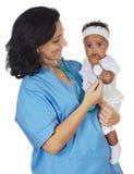 Nurse holding baby stock photography