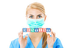 Nurse Holding Blocks Spelling Out Dentist Over White Background Stock Image