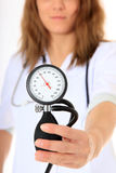 Nurse holding blood pressure meter Royalty Free Stock Photo