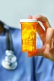 Nurse holding bottle of pills Royalty Free Stock Photography