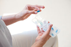 Nurse holding box with medicals. Take pills. Close up of nurse holding box with different pills Stock Images