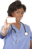 Nurse holding business card Stock Photos