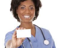 Nurse holding business card. Black nurse wearing scrubs on white isolated background Stock Photo