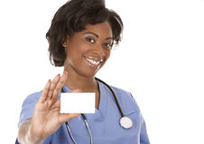 Nurse holding business card Stock Photo