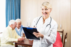 Nurse holding a clipboard Stock Images