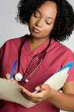 Nurse Holding File Stock Image