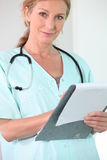 Nurse holding file Stock Images