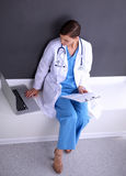 Nurse holding folder and taking notes - sitting Royalty Free Stock Photo