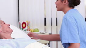 Nurse holding the hand of a senior patient stock video footage