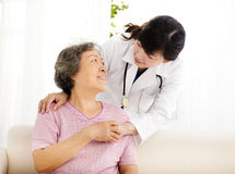 Nurse holding hand of senior woman in rest home. Nurse holding hand of asian senior women in rest home Royalty Free Stock Photos