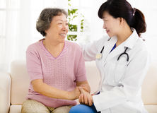 Nurse holding hand of senior woman in rest home Royalty Free Stock Photo