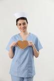 Nurse holding heart sharpe Stock Images