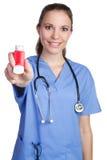 Nurse Holding Inhaler. Beautiful nurse holding asthma inhaler Stock Photography