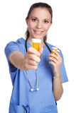 Nurse Holding Medicine. Pill bottle Royalty Free Stock Photo