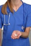 Nurse holding pills Stock Photography