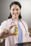 Nurse holding prescription bottle Stock Photography