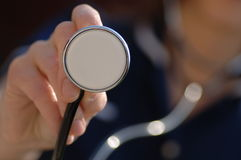 Nurse holding a stethoscope Stock Photos