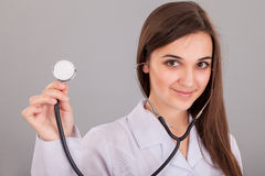 Nurse Holding Stethoscope Stock Photo