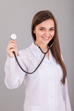 Nurse Holding Stethoscope Stock Photos