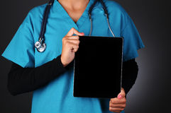 Nurse Holding Tablet Computer Royalty Free Stock Photography