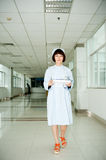 Nurse holding a tray in the aisle. Royalty Free Stock Images