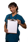 Nurse holding up blank chart Royalty Free Stock Images