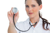 Nurse holding up stethoscope Royalty Free Stock Images