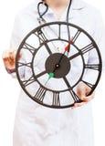 Nurse holds big clock Royalty Free Stock Photography