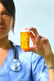 Nurse holds prescription pills royalty free stock photography
