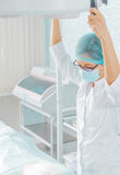 Nurse holds a surgical lamp Royalty Free Stock Photos