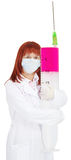 Nurse with huge syringe. A nurse with a huge syringe on white background Stock Images