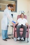 Nurse Injecting Cancer Patient During Intravenous Stock Photos