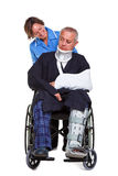 Nurse and injured man in wheelchair Royalty Free Stock Photo
