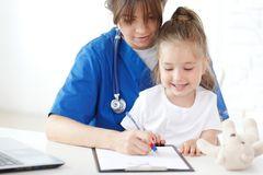 Nurse and kid Stock Image
