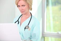 Nurse on laptop Royalty Free Stock Photo