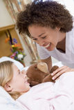 Nurse Laughing With Her Young Patient Stock Photo