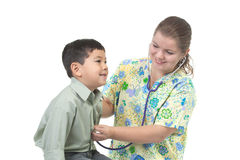 Nurse listens to heart. Royalty Free Stock Photography
