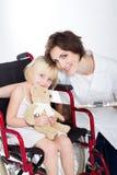 Nurse and little patient Stock Images