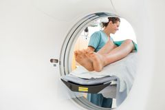 Nurse Looking Patient Undergoing CT Scan Royalty Free Stock Photos