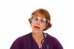 Nurse Making Goofy Face. Nurse In Her 50's With Goggles Making A Goofy Face Stock Image