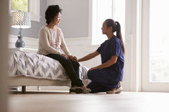 Nurse Making Home Visit To Senior Woman Stock Photo